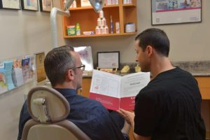 Patient with Colin Harty, Registered Denturist, during a Complimentary Consultation.